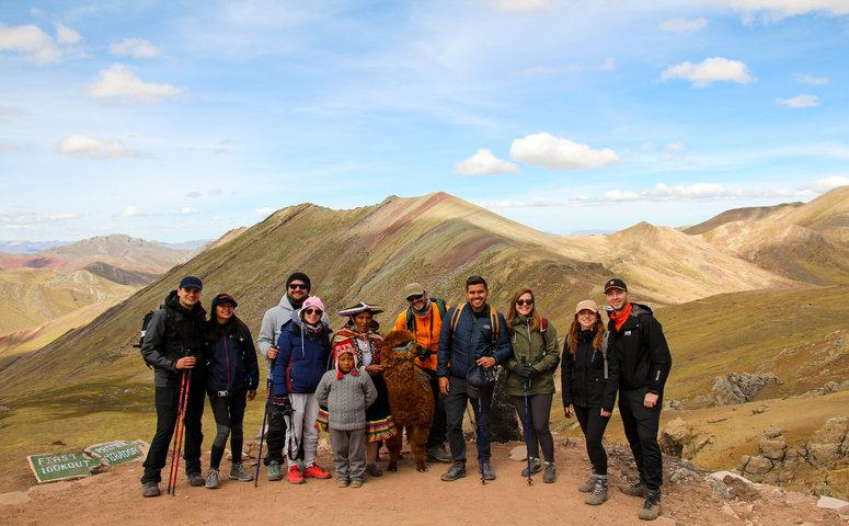 Group at Palccoyo with guide, alpaca and local