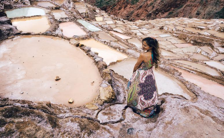 Girl standing at maras salt mines