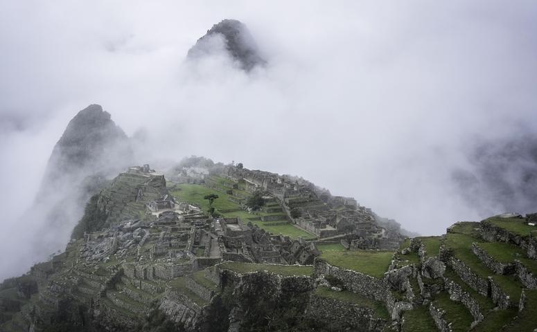 Machu Picchu ruins covered in clouds