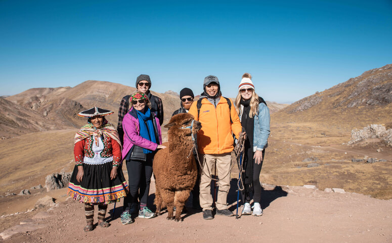Group at palccoyo with guide and alpaca