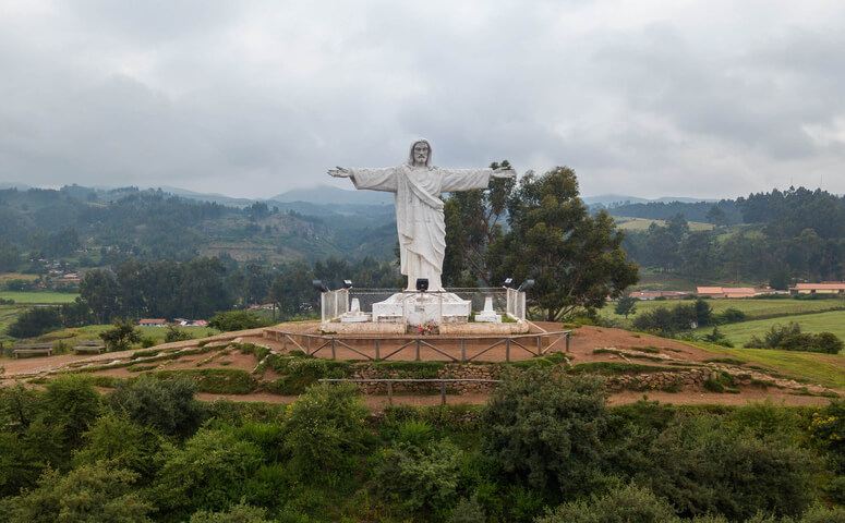 white cristo surrounded by valley