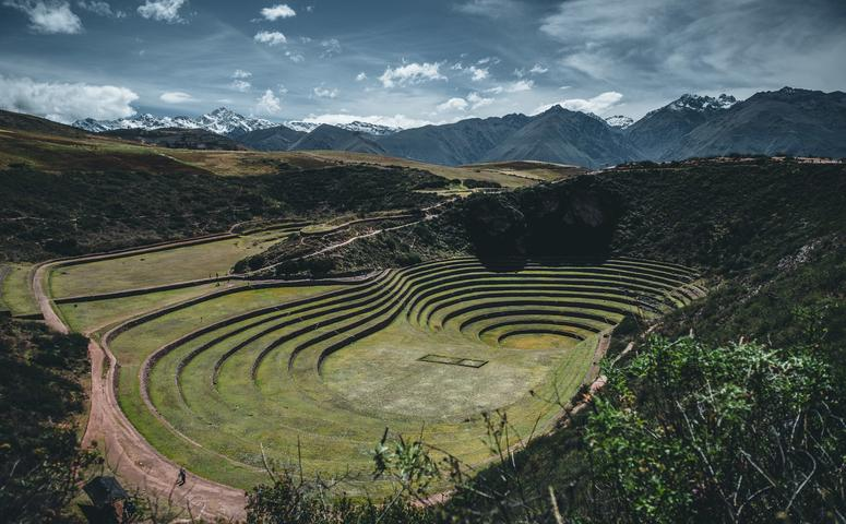 circular terraces of moray and snow-capped mountains background