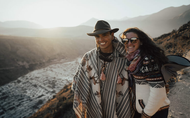 couple in poncho and traditional sweater at salt mines maras