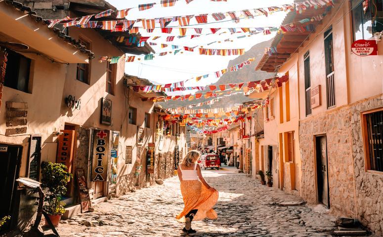 girl in orange skirt in narrow street