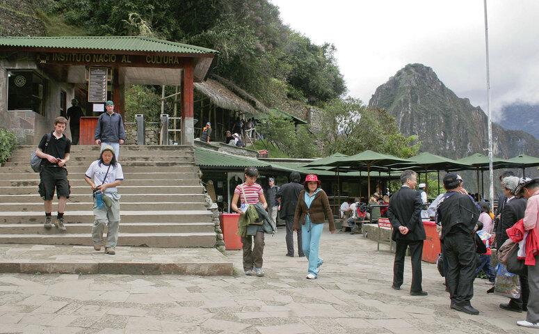 travelers at machu picchu entrance