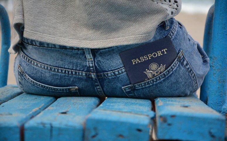 passport in rear pocket jeans