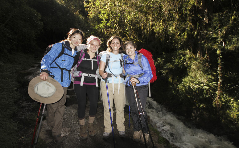 four women in hiking clothes outside