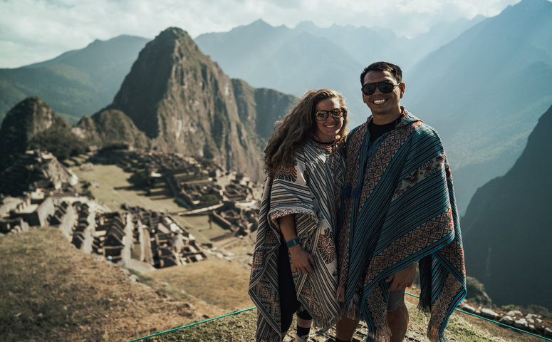 couple in ponchos at machu picchu