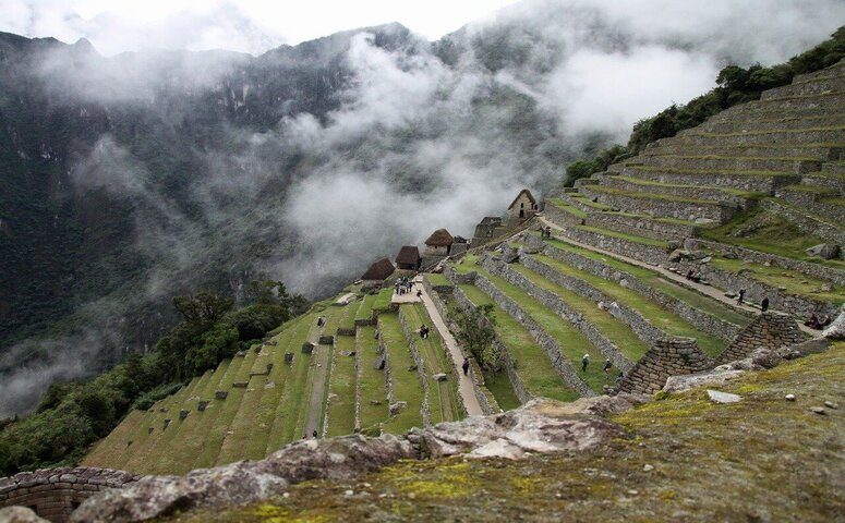 machu picchu ruins surrounded by clouds