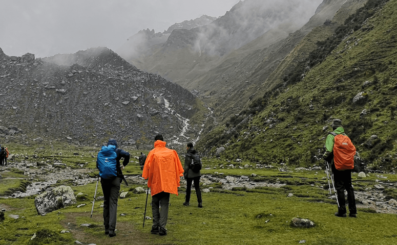travelers hiking through cloudy highlands on inca trail