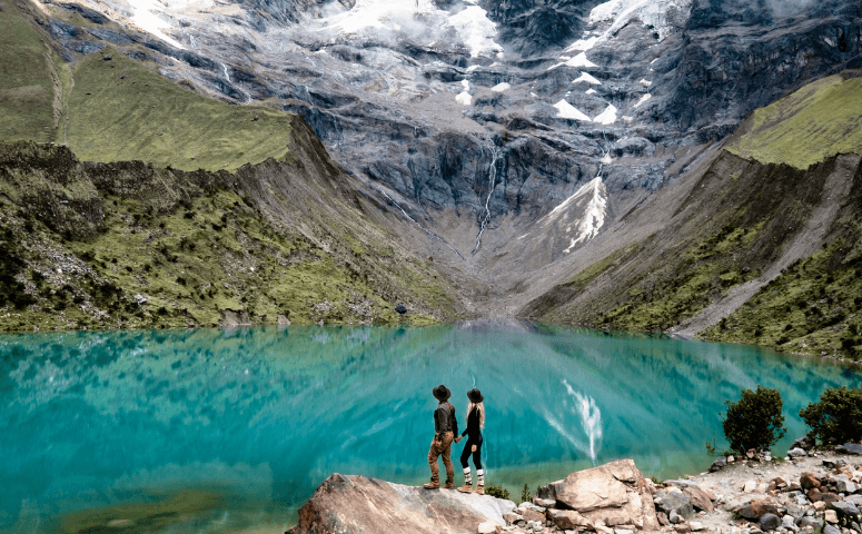 humantay lake with two travelers
