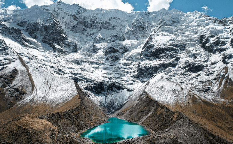 humantay lake with snow capped mountain