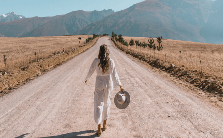 woman walking on road in sacred valley