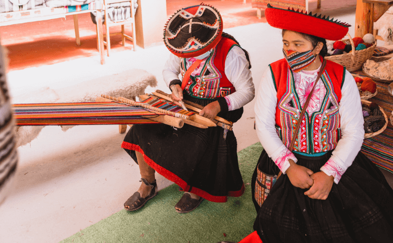 local ladies with typical clothes weaving